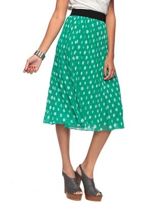 This kelly green, polka-dotted skirt can be paired with a white tee for an effortless daytime look. Pleated Polka Dot Skirt ($23)