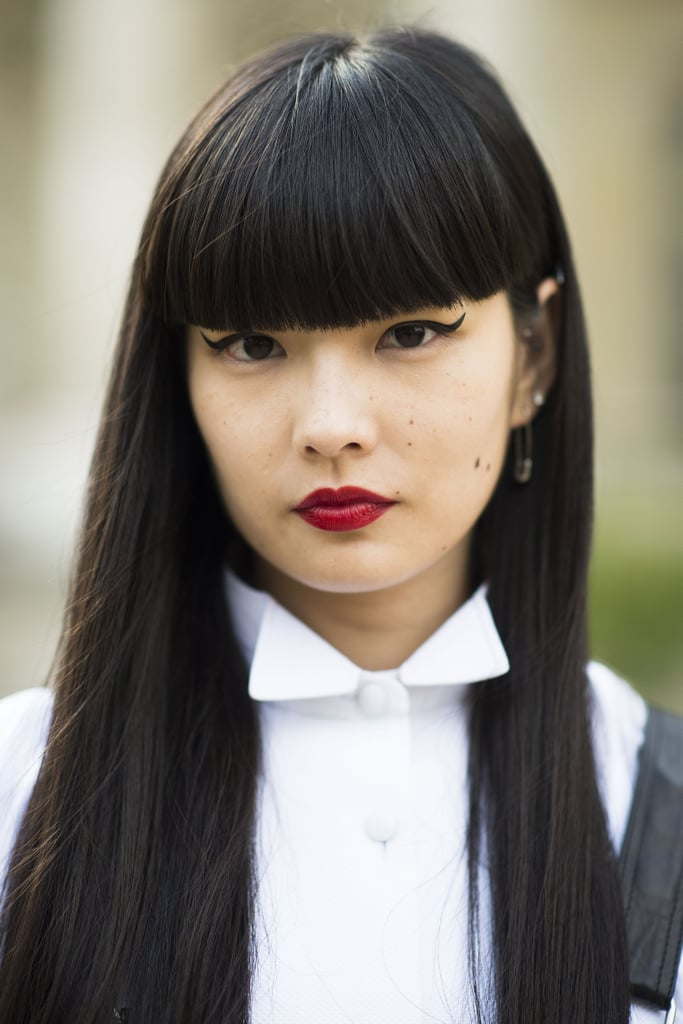 Red lipstick, blunt bangs, and cat eyeliner are absolute classics. Source: Le 21ème | Adam Katz Sinding