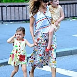 Sarah Jessica Parker mixed prints like a pro while on mommy duty in NYC. She started with a floral midi dress, then threw on a striped tee for an element of surprise.