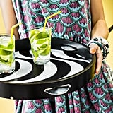 We can't wait to serve Spring cocktails on this tambourine tray ($20).