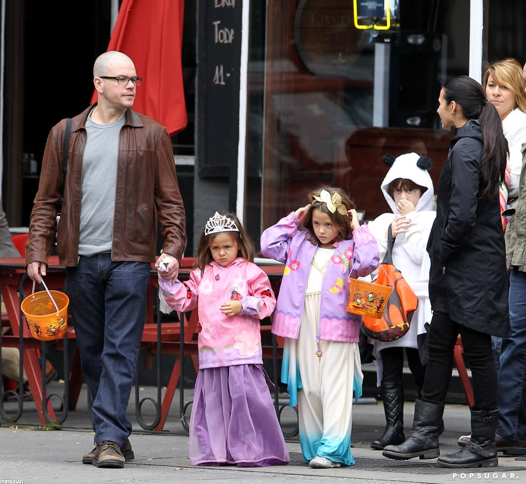 Matt Damon and his wife Luciana braved the impending Hurricane Sandy to take their daughters Isabella and Gia out trick-or-treating in NYC last night. Isabella and Gia wore princess costumes and held onto their candy as they walked the streets with a group of friends. Matt prepped for Halloween himself last week with a costumed appearance on The Colbert Report alongside Tom Hanks.  Matt and his family are back together on the East Coast after Matt made a trip to LA last week. Matt and Ben Affleck got together for a business meeting when Ben wasn't busy spending time with his kids.