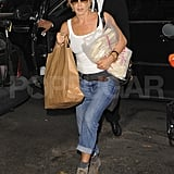 Jennifer Aniston arriving home with groceries.