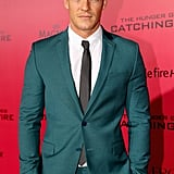 Alan Ritchson wore a green suit.