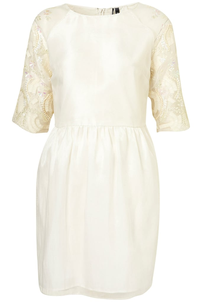 This cute cream-colored dress gets a vintage edge with pretty embellished sleeves.  Topshop Embellished Organza Tulip Dress ($160)