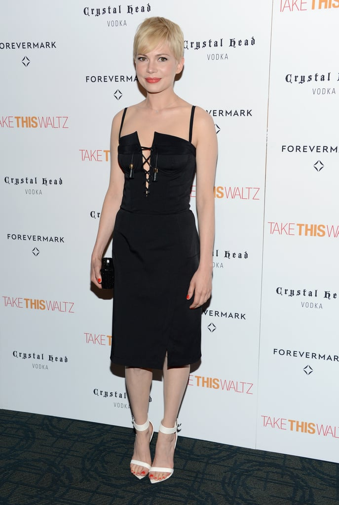 Michelle showed off her sexy side at the NYC premiere of her new movie, Take This Waltz, wearing a lace-up black Altuzarra dress paired with white Givenchy sandals and a black box clutch.