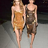 Gigi celebrating her 22nd birthday in a gold Versace dress and Christian Louboutin heels.