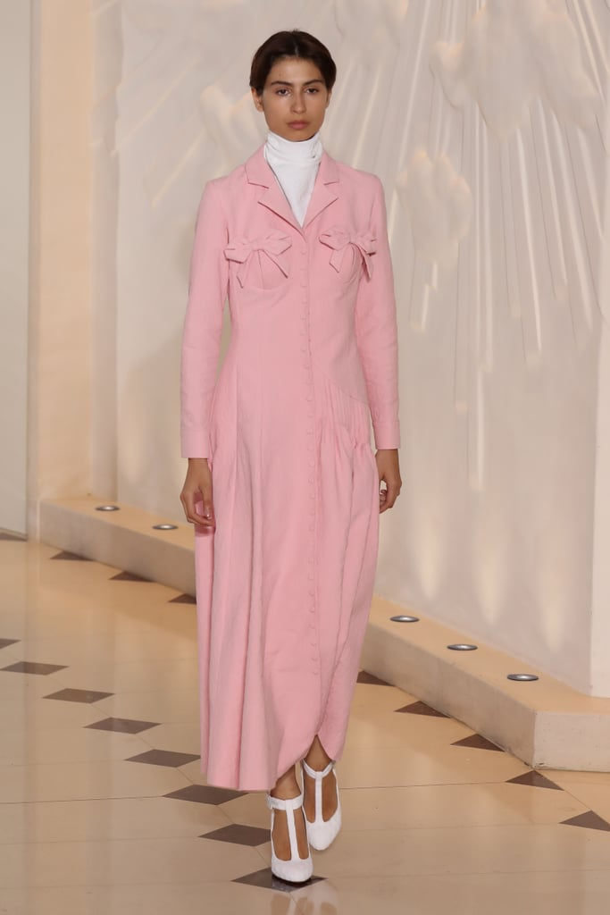 As soon as we spotted this bow-adorned blazer dress on the runway, we knew it was meant for Kate. She might modify the piece by shortening the hemline to get around easier, but we think she'd find this shade of pink to be just right.
