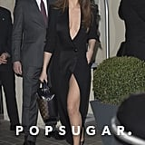 Selena brought along a Ronald van der Kemp tuxedo dress for Paris Fashion Week in 2016. Her Louis Vuitton satchel meant business, but her Soebedar mesh pumps were a playful touch.