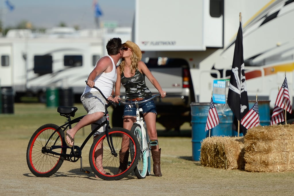 A couple smooched on bikes at Stagecoach country music festival.
