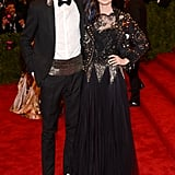 Jet-black lace, beading, and colored hair extensions helped the regal-looking Lily Collins look tougher than usual. Boyfriend Jamie Campbell Bower did his part with a metallic cummerbund.