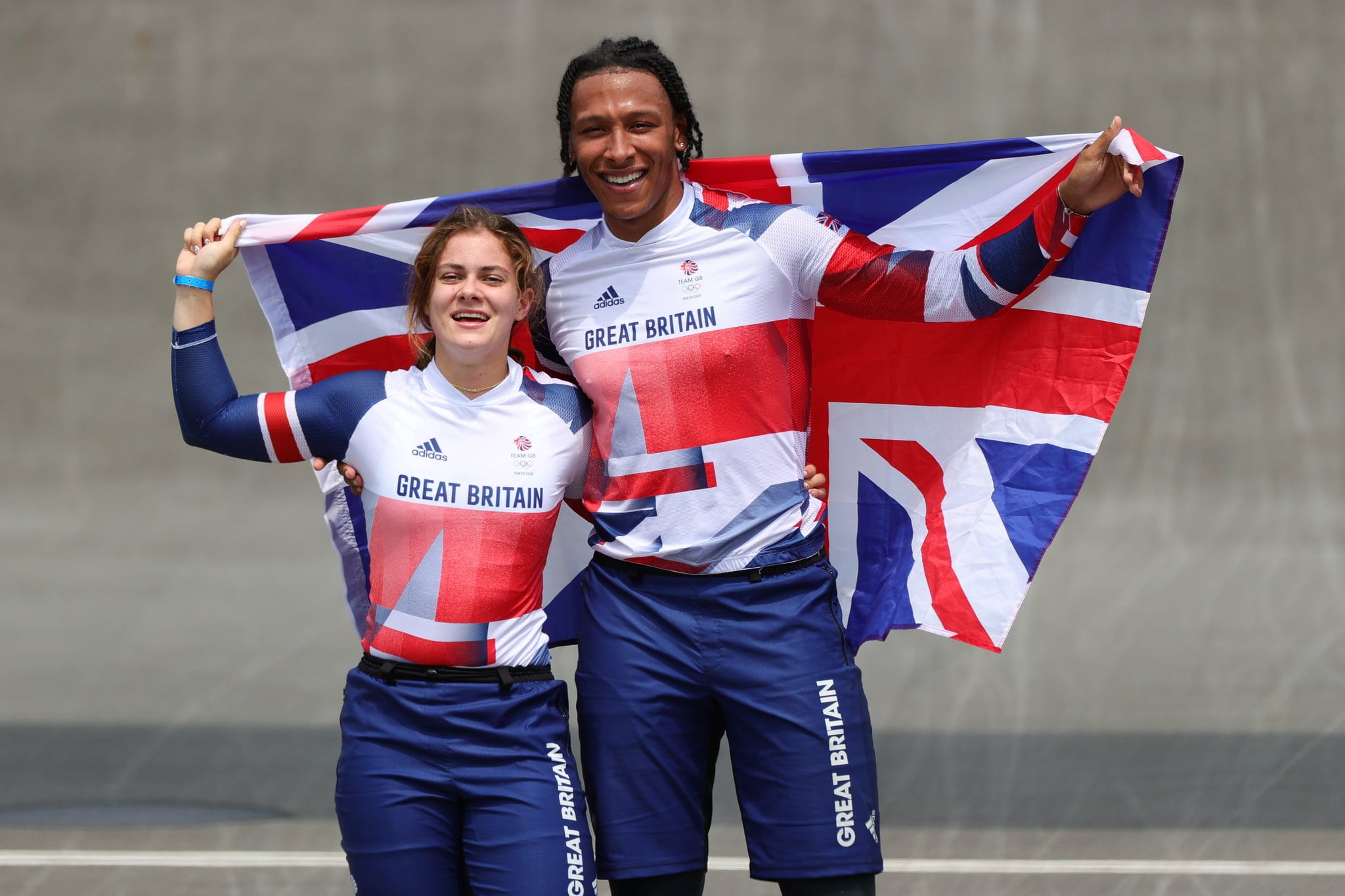 TOKYO, JAPAN - JULY 30: Bethany Shriever of Team Great Britain celebrates winning Gold with Kye Whyte of Team Great Britain Silver medalist in the Mens Final during the Men's Cycling BMX Racing Semifinal on Day 7 of the Tokyo 2020 Olympic Games at Ariake Urban Sports Park on July 30, 2021 in Tokyo, Japan. (Photo by Pete Dovgan/Speed Media/Icon Sportswire via Getty Images)