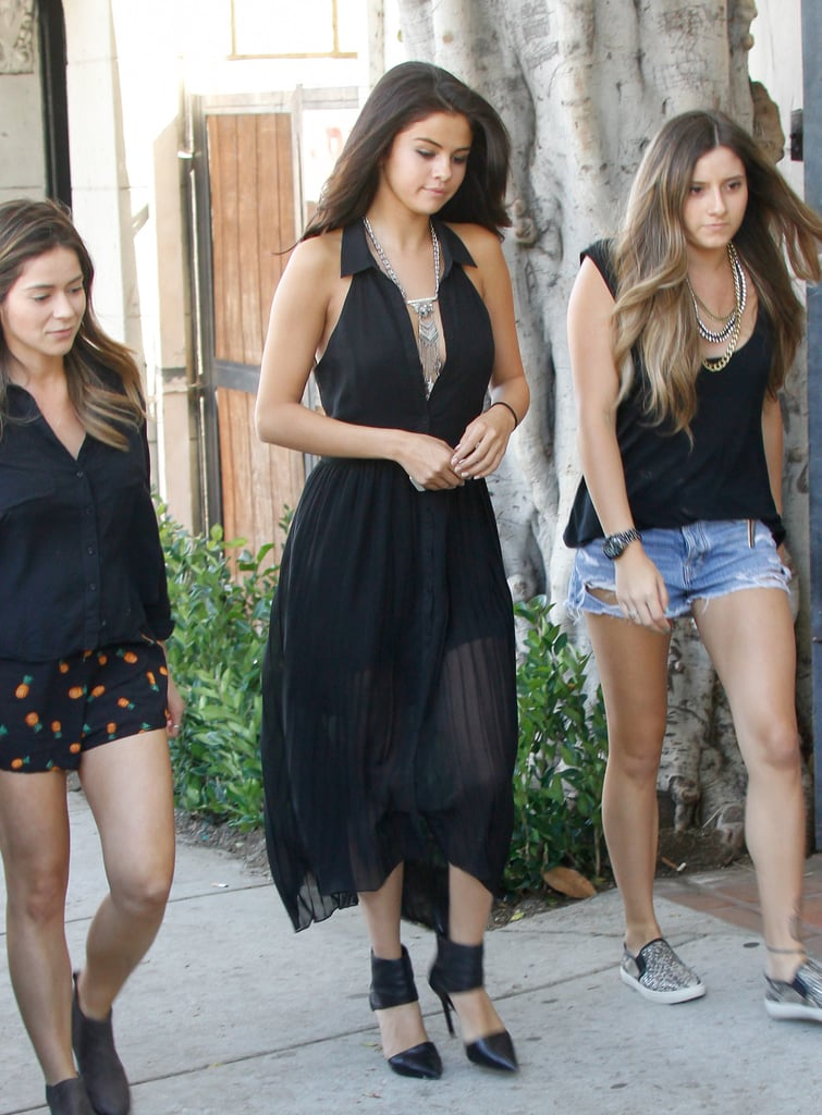 Though she was only out running errands with a couple of friends, Selena added totally stylish accessories to her pleated, halter-style frock, which made her ensemble all the more striking. From a chunky, bohemian-style drop necklace to pointed-toe heels with a thick ankle strap, Selena appears completely effortless. And frankly, this is the freshest subtly sexy getup we've seen from her in a while. Now we'll cheers to that with a little shopping.