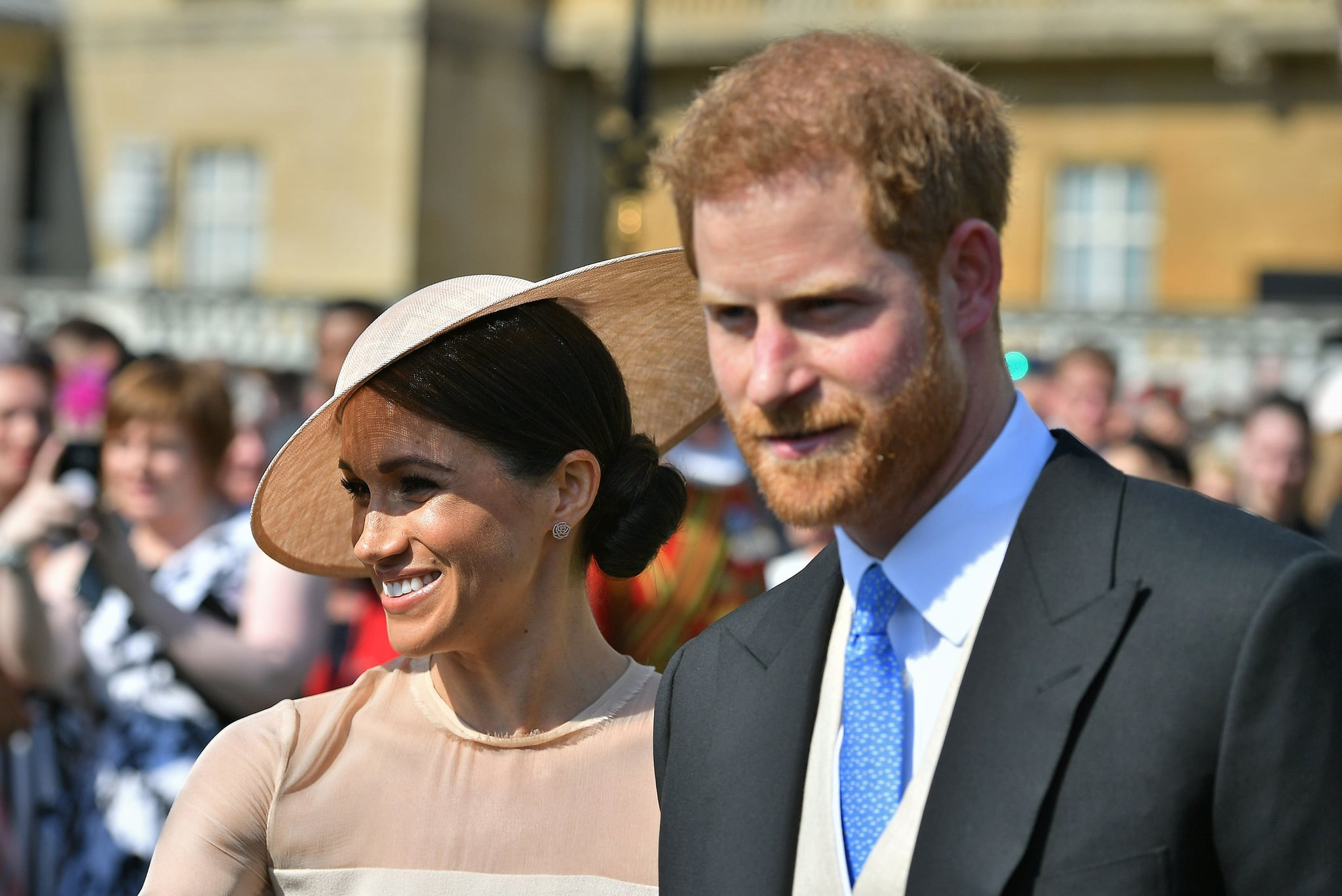 Britain's Prince Harry, Duke of Sussex (R), and his new wife, Britain's Meghan, Duchess of Sussex, attend the Prince of Wales's 70th Birthday Garden Party at Buckingham Palace in London on May 22, 2018. - The Prince of Wales and The Duchess of Cornwall hosted a Garden Party to celebrate the work of The Prince's Charities in the year of Prince Charles's 70th Birthday. (Photo by Dominic Lipinski / POOL / AFP)        (Photo credit should read DOMINIC LIPINSKI/AFP/Getty Images)