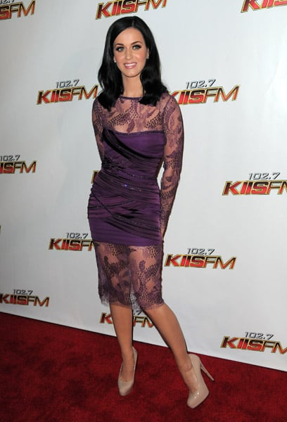 Katy Perry performed at the Jingle Bell Ball in the US wearing a purple dress with sheer lace detailing.
