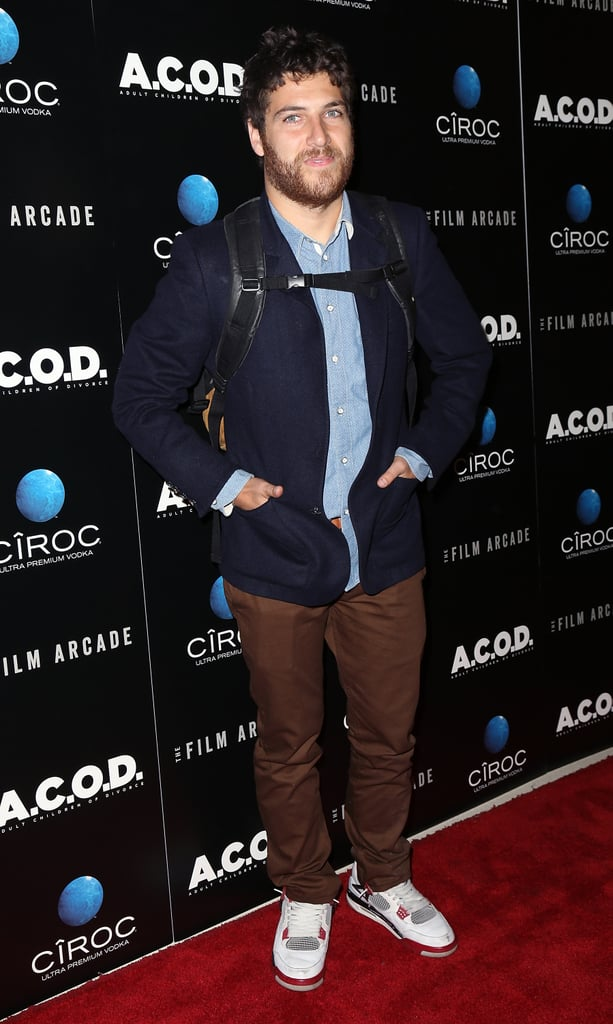 Adam Pally kept his backpack on for the red carpet.