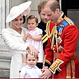 While Prince William fussed with George, Kate put a hand on his head and smiled at her son.