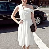 Emma Roberts walked around Lincoln Center in an ethereal, asymmetrical chiffon dress and black accessories.