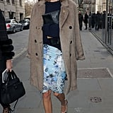 While going from one show to another, Alexa wore a ladylike outfit that has a vintage-cum-cool edge. She paired a blue floral knee-length skirt with a navy sweater and metallic ankle-strap wedges and topped it all off with a beige fur coat.       Crewnecks & Scoopnecks by LOFTSandals at Net-A-Porter