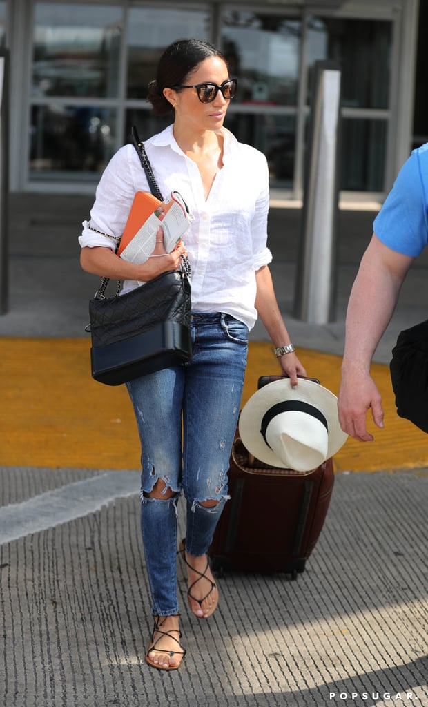 It's confirmed: Meghan Markle's a J.Crew gal. She touched down in Austin, TX, earlier this year in a travel outfit almost entirely composed of classics from the brand. She wore a white button-down and sunglasses from the retailer, and finished off the look with a pair of blue jeans with rips at the knee. She toted around Ghurka luggage. Meghan's J.Crew shoes, however, were the most eye-catching of all. The leather lace-up sandals (which you can still shop for $88) provided a casual, preppy touch to her polished ensemble. We can easily see fashion girls pairing these with a dress or cut-offs for Summer. You can basically buy Meghan's entire airport look below.      Related:                                                                                                           Meghan Markle's Style Isn't Quite Like Kate Middleton's, but It's Still Approved by the Royal Court