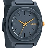The best part about this Nixon Time Teller watch ($75) — besides it being water-resistant, of course — is the little pop of orange the hands give against the gray rubber case. It's sporty and stylish and can go from the city to the surf without missing a beat.  — RK
