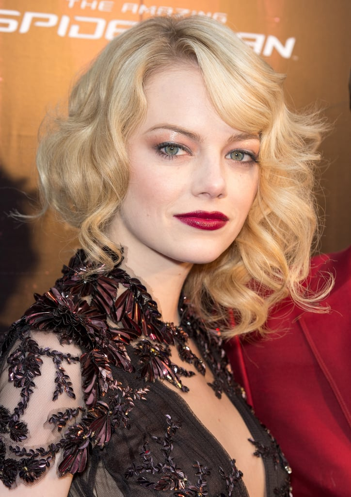Emma Stone went all-out Daisy Buchanan for The Amazing Spider-Man premiere in Paris with glossy eyelids, deep red lipstick, and a curled faux bob.