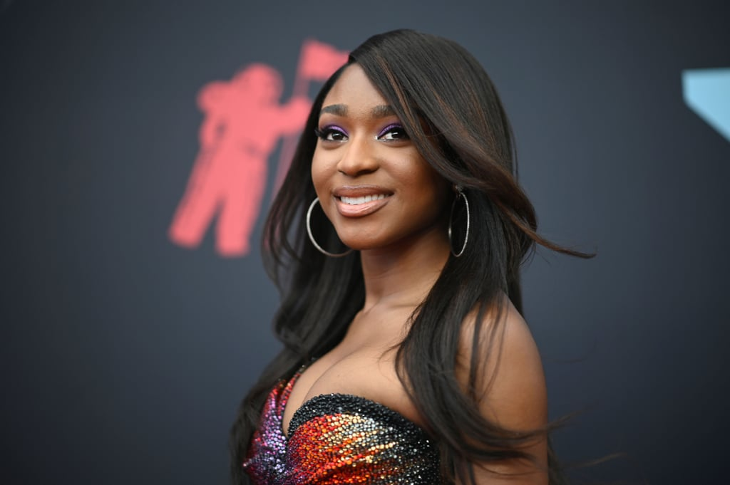 "Normani came to take all her things at the 2019 MTV VMAs, and we were here for it, honey! The ""Motivation"" singer graced the red carpet in a slinky dress that bared some devastating abs and a lot of leg, letting us all know she didn't come to play with the carpet, or our edges. Her look gave us everything from Destiny's Child ""Survivor"" to Mariah Carey's entire Butterfly motif, which is along the same vibes that her nostalgic video gave fans, so we're sensing a theme!  It was a big night for the 23-year-old singer; not only did her music video for ""Waves"" featuring 6LACK win for best R&B video, but she also performed during the main show. It was Normani's first-ever solo performance at the award show, and she absolutely killed it. Keep scrolling for more looks at Normani's superfly night at the VMAs ahead!      Related:                                                                                                           Not to Be Dramatic or Anything, but These VMAs Outfits Are the Definition of Fierce Fashion"