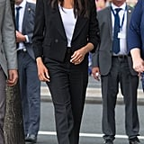 Meghan sported a relaxed white tee underneath this Givenchy pantsuit in Ireland in July 2018.