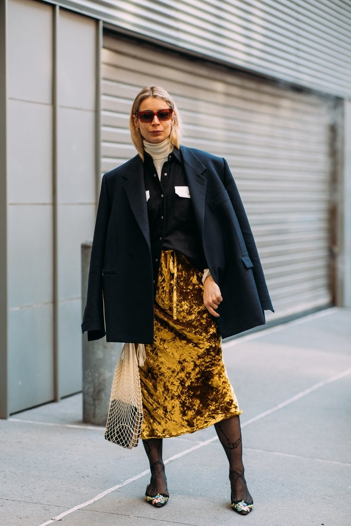 A velvet skirt adds texture and dimension to an outfit.