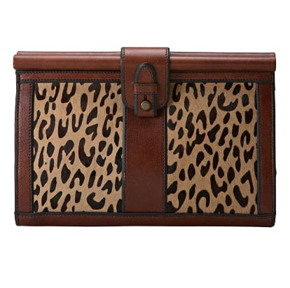 The sophisticated structure and leather detailing looks oh-so-cool juxtaposed with the big cat print.   Fossil Vintage Reissue Clutch ($148)