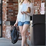 Kirsten Dunst did cutoffs the grown-up way with a ladylike blouse and ankle-strap sandals.