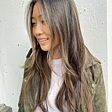 """You can also try the honey blond color as a subtle balayage for a seamless grow out, which allows you to """"add dimension without going full blond,"""" she said. """"It's a nice chocolate brown base with caramel pops of color — subtle, pretty, and summery."""""""