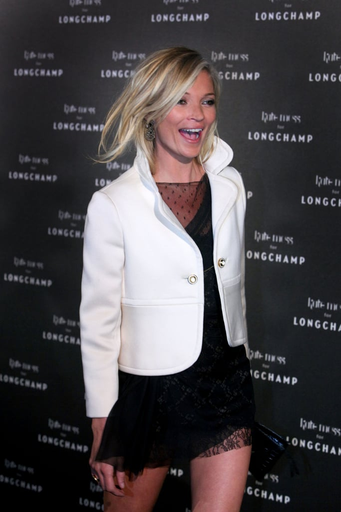 """>> Last night to close out couture, Kate Moss held a launch party for her first Longchamp handbag collection at the Ritz Club in Paris. With zebra print everywhere — on the carpet, on the walls — which has become somewhat a signature for the line, featured in both the lining and a scarf that can be tied around the handbag strap, Moss and her silver-streaked hair were joined by the likes of boyfriend (maybe fiance?) Jamie Hince, Maryna Linchuk, Frida Gustavsson, Lauren Santo Domingo, Hamish Bowles, Giovanna Battaglia, Giambattista Valli, and Carine Roitfeld, who coincidentally wore a zebra print coat the day before. Moss said of the collaboration: """"'I've been working with Longchamp for a while — we just get on. It was a fabulous opportunity for me."""" She named the bags, out Feb. 11, The Glastonbury, after her favorite music festival, The Soho, and The Glouchester — prices start at $155 for a small purse, clutches are $490 to $780, handbags are $780 to $1,700, and weekend bags are $1,290 to $2,500. Already, a video of her campaign shoot has popped up — the ads will run with taglines like """"Don't You Wish Your Bag Was Hot As Kate's?,"""" """"An Absolute Moss-have,"""" """"Kate Is Not A Plastic Bag,"""" and """"My Moss Bag Brings All The Boys To The Yard."""""""