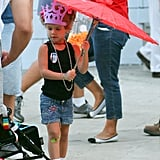 Honor kept out of the sun with the help of her red umbrella.