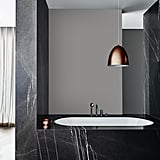Monochrome, in its purest black and white form, Andrea confirmed, is officially dead. Dulux's Construct colour scheme (seen above) is the evolution of monochromatic interiors. There's a lot more inky blue and blue-based greys with just a sprinkling of shimmer effect coppers and pewter.
