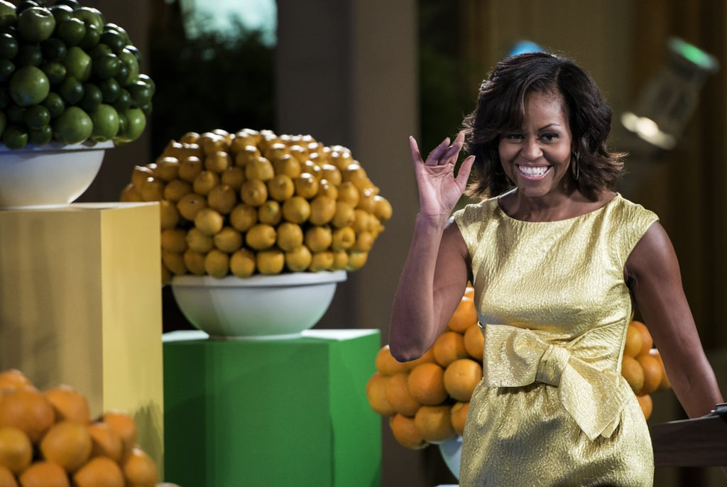 Michelle Obama shined in a gold metallic Michael Kors dress featuring an oversize bow at a kids' state dinner held at the White House.