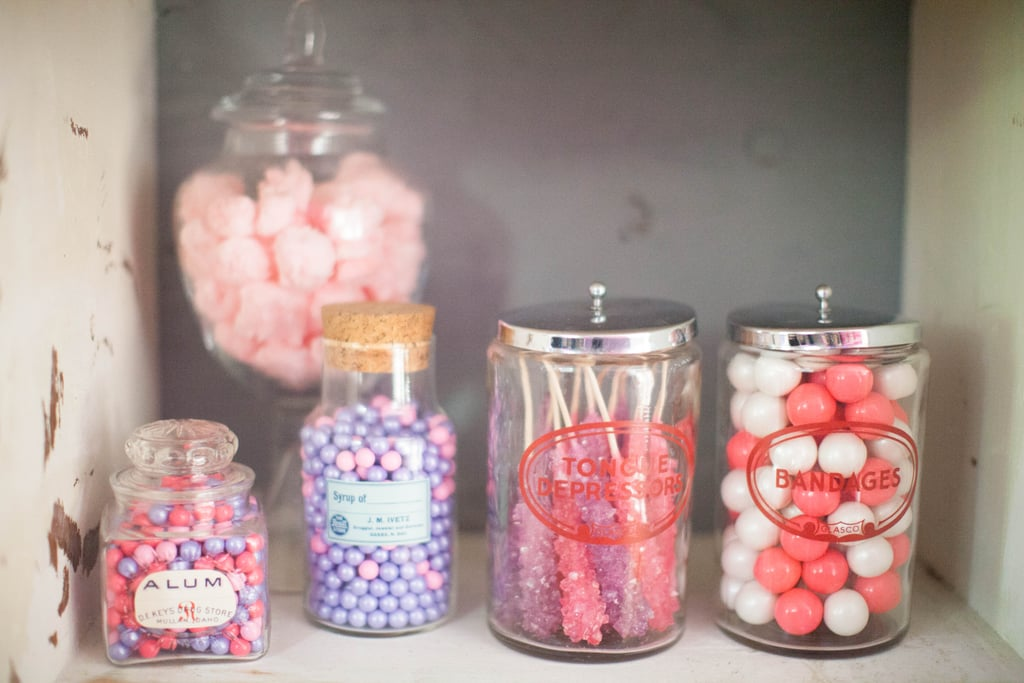 "Check out all of the fun candy options the kids had for the prescription bottles! ""We filled vintage medical glass canisters with pink and purple rock candy and rolled cotton candy 'cotton balls,'"" Jenny said. ""Pink and purple candy filled apothecary jars."" Source: Jenny Cookies"