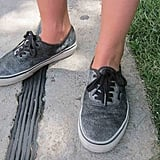 Silver glitter paint helped create a dusty metallic cover to these traditional lace-up Vans.