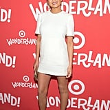 Chrissy's baby bump was barely visible in a white minidress, which she paired with bold gold pumps.