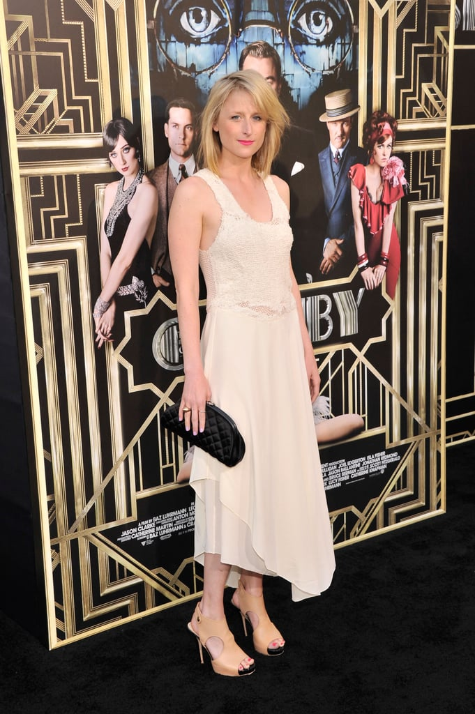 Mamie Gummer looked '20s chic in an asymmetrical silk and knit dress paired with nude platform sandals and a quilted clutch.