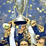 David Beckham held up the MLS cup.