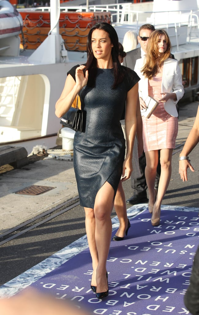 Megan Gale sticks to her glamazon roots in this form-fitting leather number. Note the Valentino bag and Louboutin heels.