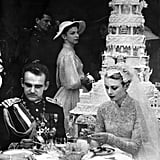 Princess Grace and Prince Rainier's wedding cake is seen in the background.