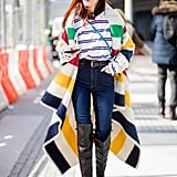 Taylor Tomasi Hill proves high-waisted, slim-fit denim is a perfect classic for anchoring bold stripes and statement boots.