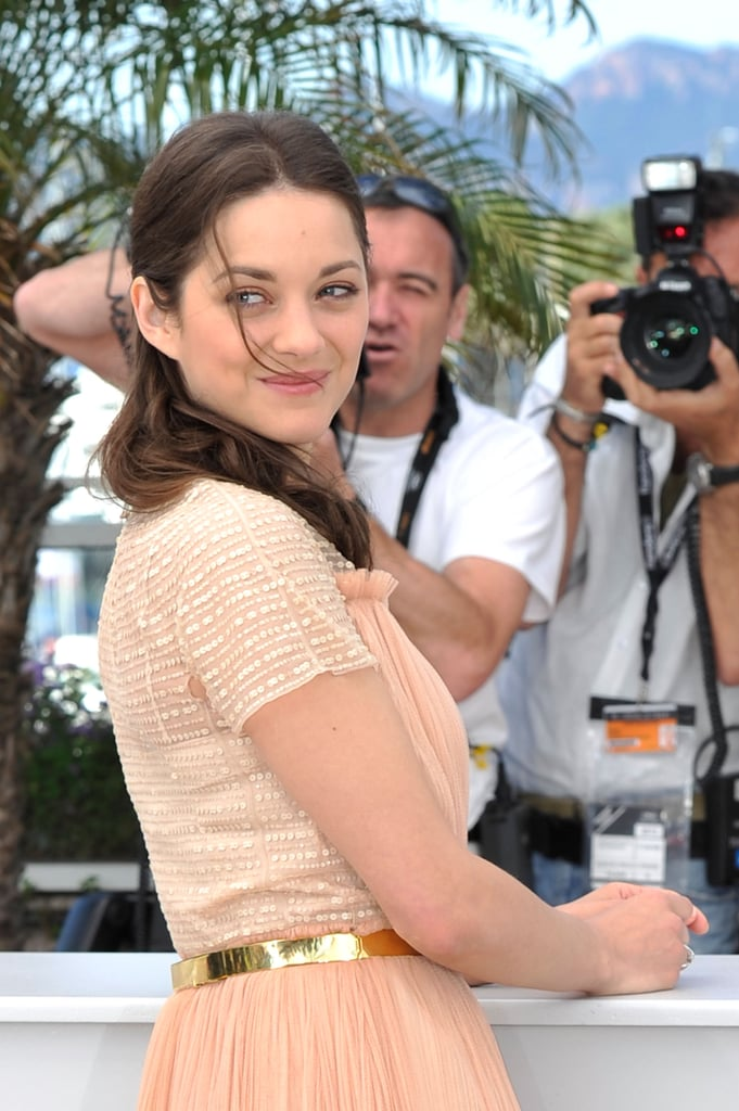 Marion Cotillard gave a smile at the Rust and Bone photocall in Cannes.