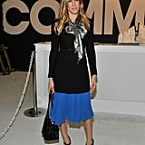 We love the combination of SJP's pleated cobalt skirt, metallic bow-tie blouse, and ankle-strap pumps at the ENK Fashion Coterie in February 2011.