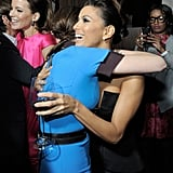Eva Longoria and Victoria Beckham shared a hug.