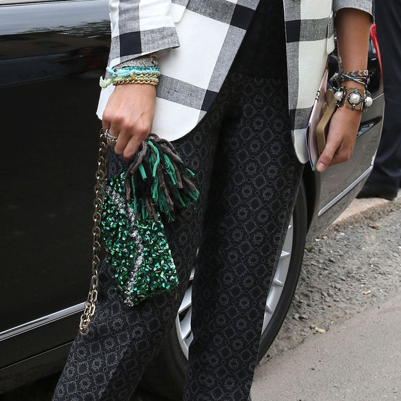 This is how it's done. Arm-loads of bangles and a one-of-kind clutch have ample personality. Source: Greg Kessler