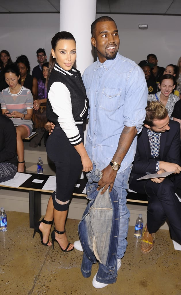 Kim Kardashian and beau Kanye took front row at Louise Goldin — with Kim showing off the varsity-jacket trend.