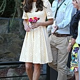 Mystery designer in Sydney: The independent designer of this pale yellow eyelet dress has never been revealed, but it has become a favourite of Kate's. Worn in Sydney with tan 'Minx' Stuart Weitzman wedges.