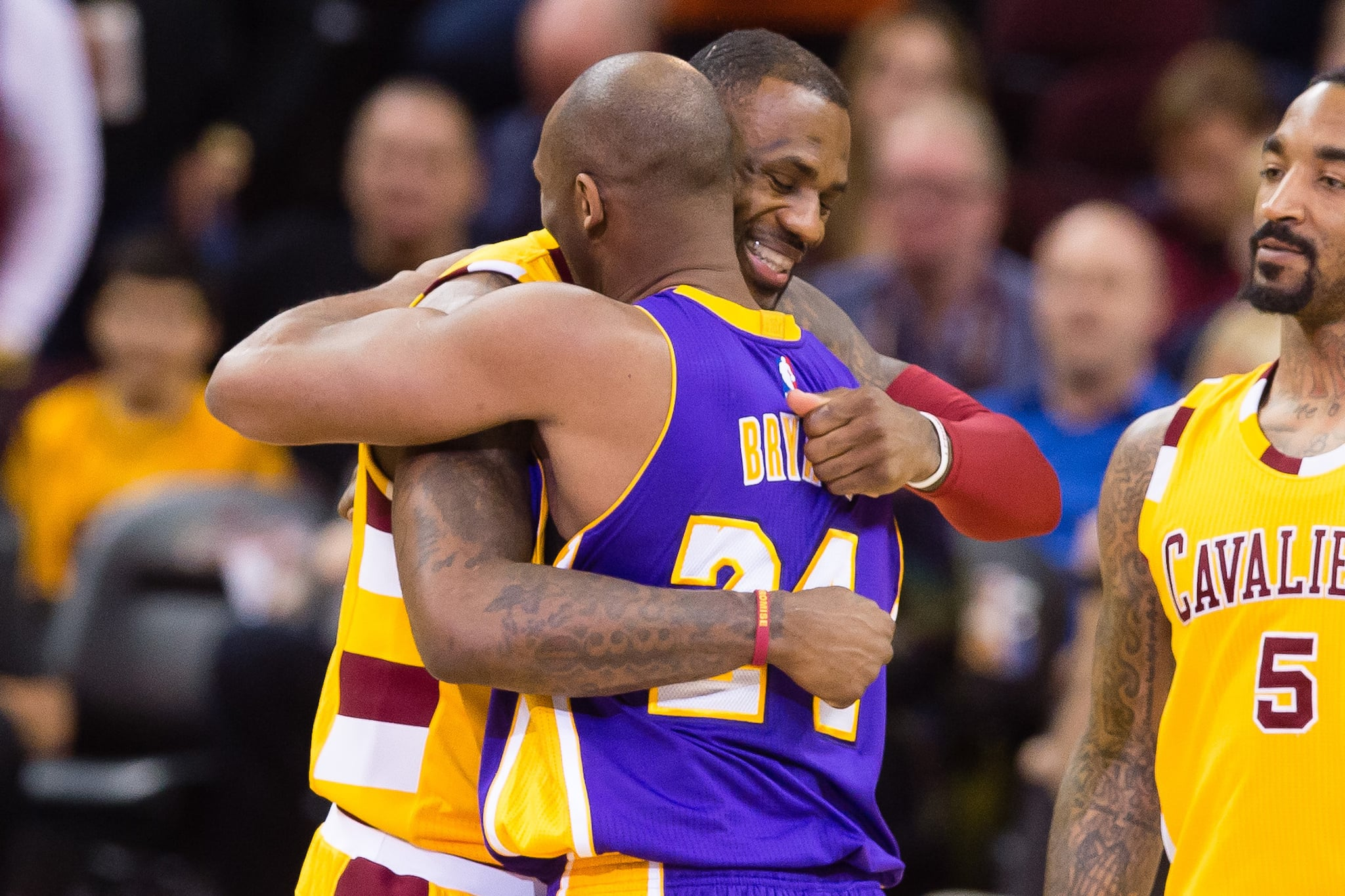 CLEVELAND, OH - FEBRUARY 10: LeBron James #23 of the Cleveland Cavaliers greets Kobe Bryant #24 of the Los Angeles Lakers during the first half at Quicken Loans Arena on February 10, 2016 in Cleveland, Ohio. NOTE TO USER: User expressly acknowledges and agrees that, by downloading and/or using this photograph, user is consenting to the terms and conditions of the Getty Images Licence Agreement. Mandatory copyright notice. (Photo by Jason Miller/Getty Images) *** Local Caption ***LeBron James; Kobe Bryant